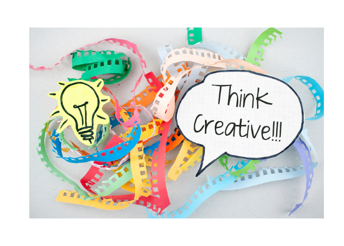 Think Creative thought bubble with colourful paper