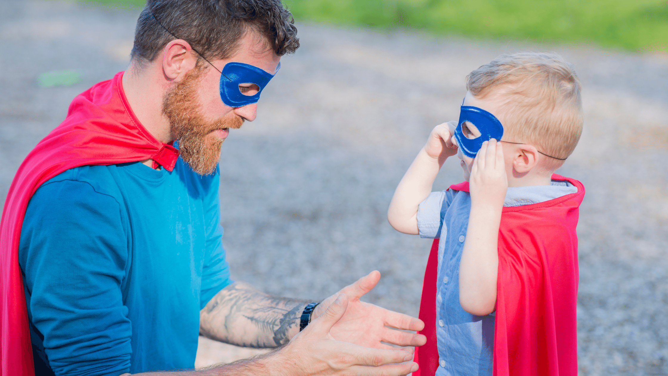 Dad and son wearing superhero costumes