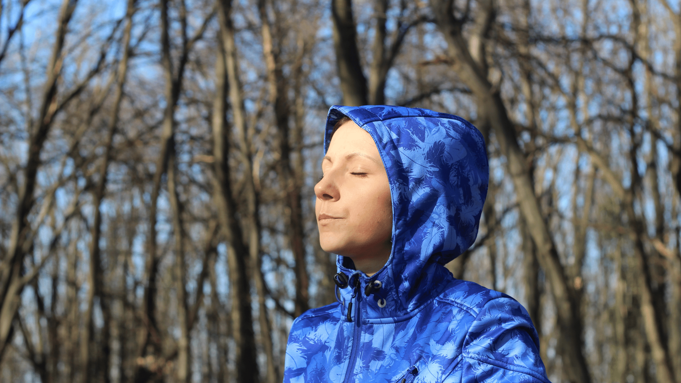 Woman in nature taking deep breaths