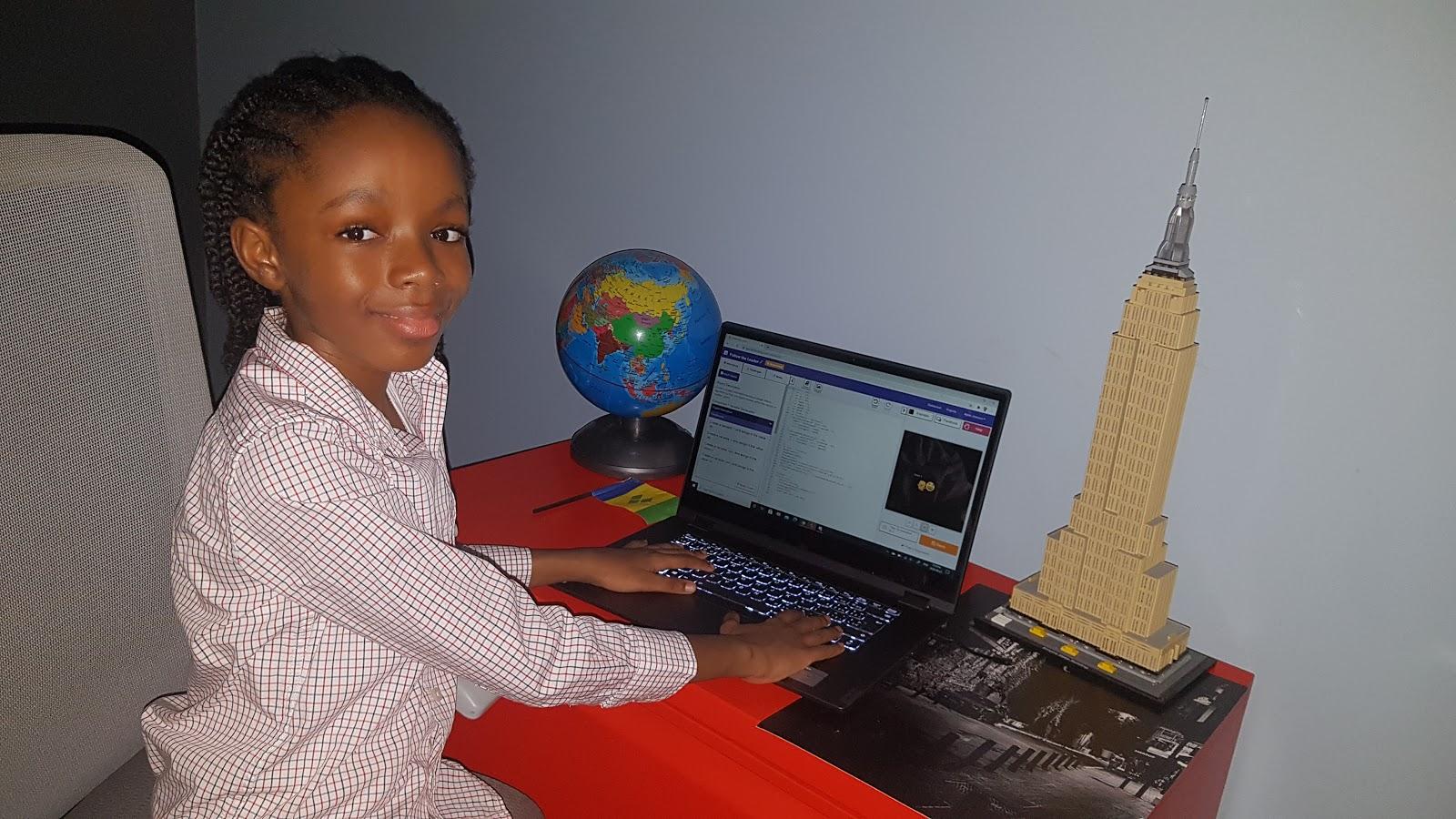 Nyles at his computer, coding.