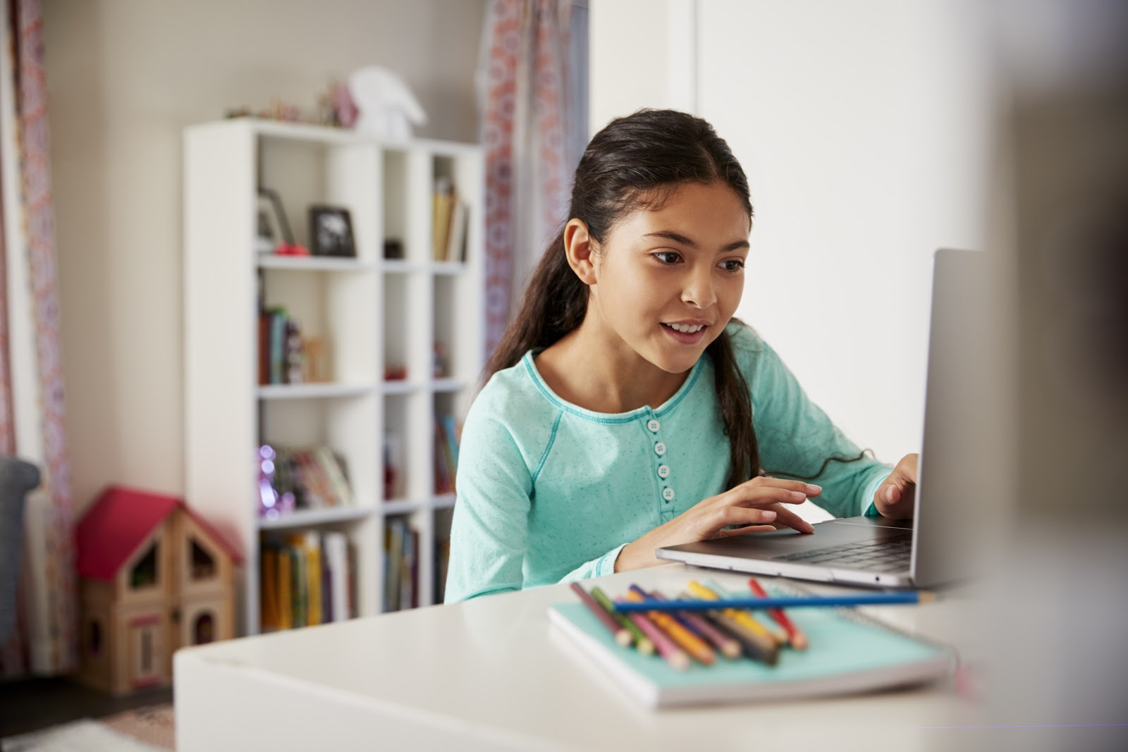 Girl smiling at her laptop computer