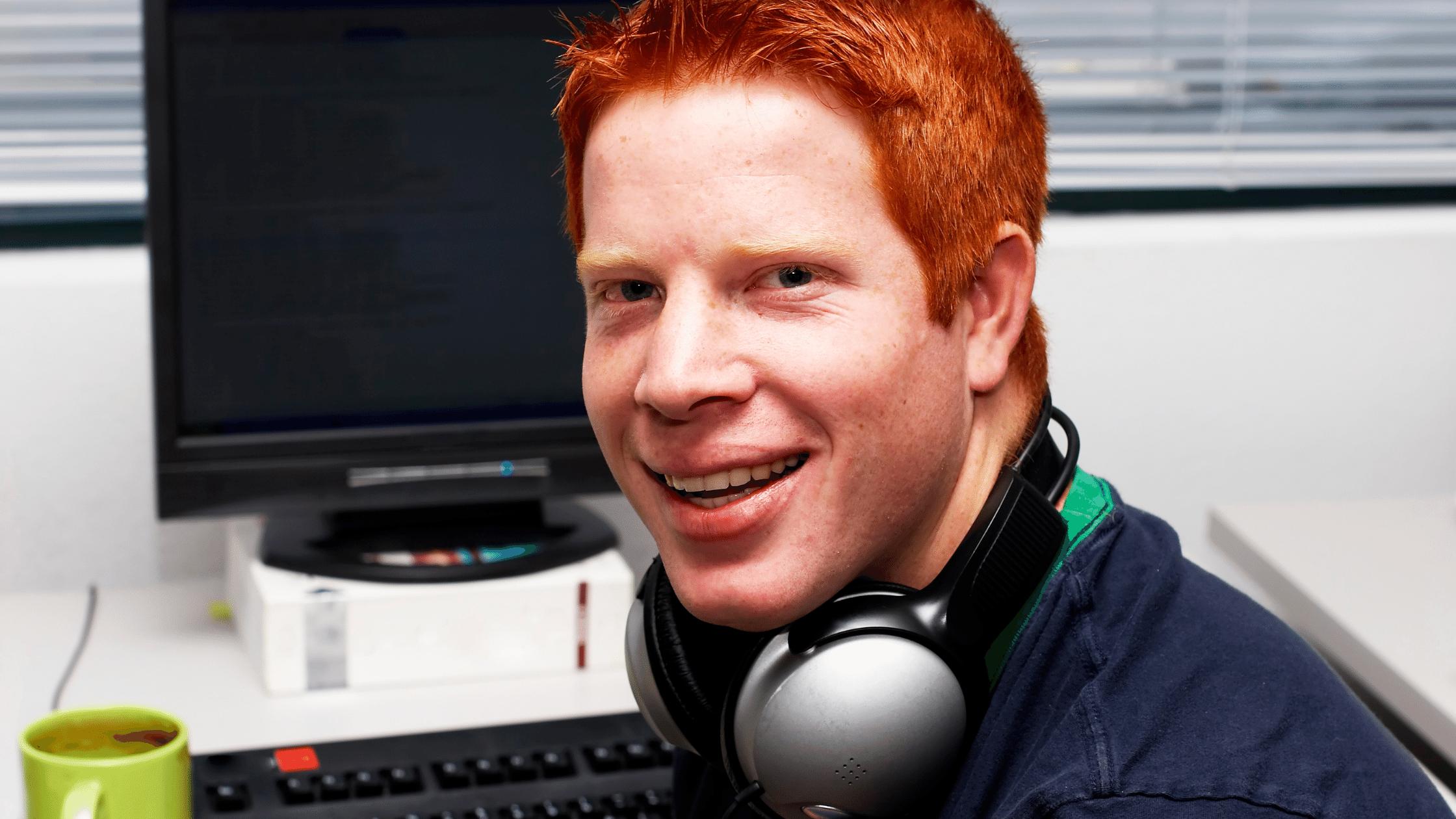 Programmer smiling at computer